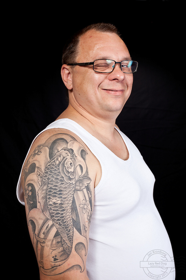 Danish man with a koifish tattoo on his upper right shoulder.<br />