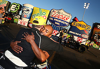 Feb 8, 2015; Pomona, CA, USA; Runner-up Antron Brown congratulates NHRA top fuel driver Shawn Langdon as he celebrates after winning the Winternationals at Auto Club Raceway at Pomona. Mandatory Credit: Mark J. Rebilas-