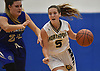 Shea Cronin #5 of Northport, right, dribbles downcourt during a Suffolk County League II girls basketball game against Riverhead at Northport High School on Friday, Dec. 14, 2018. She recorded eight points and three steals in Northport's 48-21 win.