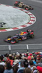 Red Bull Racing driver Mark Webber of Australia speeds his RB8 car and Lotus F1 Team driver Kimi Raikkonen of Finland speeds his E20 car during the F1 Grand Prix du Canada at the Circuit Gilles-Villeneuve on June 08, 2012 in Montreal, Canada. Photo by Victor Fraile / The Power of Sport Images