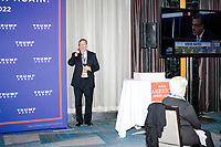 A man talks on a phone outside the ballroom in the Midtown Hilton at the election night victory rally for Republican presidential nominee Donald Trump, on Tues., Nov. 8, 2016. Trump was named president-elect in the early hours of Nov. 9, 2016.