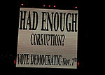 "New Hyde Park, New York, USA. October 23, 2017. ""Had Enough Corruption? Vote Democratic Nov 7th"" lighted sign outside Nassau County Democratic Committee Annual Fall Dinner, at Inn at New Hyde Park, with JAY JACOBS Chairman, and with guest speaker Governor ANDREW CUOMO. Laura Curren, the candidate for Nassau County Executive, also spoke."