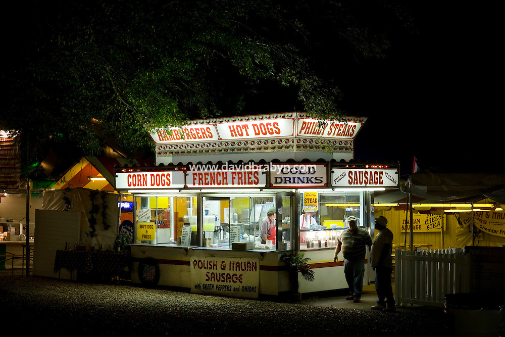 View of a food vendor stand selling corn dogs, french fries, cold drinks, sausage, hamburgers, hot dogs and Philly steaks at the North Carolina State Fair in Raleigh, NC, United States, 16 October 2008.