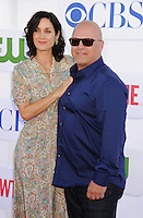 BEVERLY HILLS, CA - JULY 29: Carrie-Anne Moss and Michael Chiklis arrive at the CBS, Showtime and The CW 2012 TCA summer tour party at 9900 Wilshire Blvd on July 29, 2012 in Beverly Hills, California. /NortePhoto.com<br />