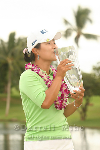 Feb 24, 2006; Kapolei, HI, USA; Meena Lee kisses her trophy after winning the inaugural LPGA Fields Open at Ko Olina Resort...Photo Credit: Darrell Miho.Copyright © 2006 Darrell Miho