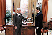 United States President Ronald Reagan meets with Ambassador Paul Nitze in the Oval Office of the White House in Washington, DC on December 5, 1984.  The President asked Ambassador Nitze to serve as advisor to the Secretary of State for the Geneva talks.<br /> Mandatory Credit: Pete Souza / White House via CNP
