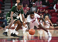 NWA Democrat-Gazette/J.T. WAMPLER Arkansas' Darius Hall leaps after a loose ball against Colorado State's J.D. Paige Tuesday Dec. 5, 2017 at Bud Walton Arena in Fayetteville. The Hogs won 92-66 and play again at home Saturday against Minnesota.