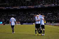 BUENOS AIRES, ARGENTINA, 22 MARÇO 2013 - COPA 2014 - ELIMINATORIAS SUL-AMERICANA - ARGENTINA X VENEZUELA - Higuaín (9) jogador da Argentina é abraçado por Lionel Messi (C) durante partida contra a Venezuela em partida pela 11 rodada das eliminatórias sul-americana para a Copa do Mundo de 2014 no Estádio Monumental de Núñes em Buenos Aires capital da Argentina, na noite desta sexta-feira, 22. (FOTO: JUANI RONCORONI / BRAZIL PHOTO PRESS).
