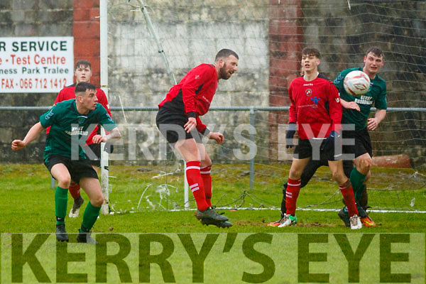 Dynamos Dillon Robinson clears his defence as Fenit Samphires put on pressure in their encounter on Sunday last in Tralee.