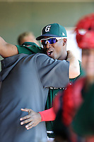 Designated hitter Carlos Mesa (28) of the Greenville Drive pumps up his teammates during game against the Charleston RiverDogs on Sunday, June 28, 2015, at Fluor Field at the West End in Greenville, South Carolina. Charleston won, 12-9. (Tom Priddy/Four Seam Images)