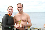 Sue McKinney presents Ciaran Farrelly with 1st Prize at the Green Buoy 1KM Swim in Clogherhead....(Photo credit should read Jenny Matthews/NEWSFILE)...
