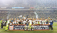 The Seattle Sounders FC pose for a photo after winning their third consecutive U.S. Open Cup after play between the Seattle Sounders FC and the Chicago Fire in the U.S. Open Cup Final at CenturyLink Field in Seattle Tuesday October 4, 2011. Seattle won the game 2-0.