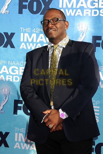 RANDY JACKSON .at The 42nd Annual NAACP Awards held at The Shrine Auditorium in Los Angeles, California, USA,.March 4th 2011..arrivals half length glasses tie patterned print shirt gold paisley earrings navy blue suit pink wrist watch .CAP/ADM/BP.©Byron Purvis/AdMedia/Capital Pictures.