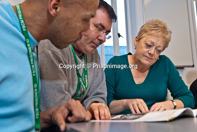 Prisoners working with the Open University course leader to select their course. Open University are working with prisoners in the education department at HMP Featherstone. course leader to select their course. Open University working with prisoners in the education department at HMP Featherstone.