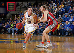 BROOKINGS, SD - FEBRUARY 4:  Sydney Palmer #32 from South Dakota State drives past Jaycee Bradley #12 from the University of South Dakota during their game Saturday afternoon at Frost Arena in Brookings. (Photo by Dave Eggen/Inertia)