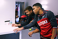 (L-R) Fernando Llorente and Jefferson Montero play with a bottle top in the foyer during the Swansea City Training at The Fairwood Training Ground, Swansea, Wales, UK. Wednesday 16 August 2017