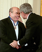 "Washington, D.C. - December 15, 2006 -- Natan Sharansky  shakes hands with United States President George W. Bush after receiving the Presidential Medal of Freedom from The President and first lady Laura Bush during a ceremony in the East Room of the White House on Friday, December 15, 2006.  The medal is the nation's highest civil award.  It may be awarded ""to any person who has made an especially meritorious contribution to (1) the security or national interests of the United States, or, (2) world peace, or (3) cultural or other significant public or private endeavors"".   Natan Sharansky's life is the story of good conquering evil and an illustration of the strength of the human spirit.  Imprisoned by the Soviet regime for his work to advance religious liberty and human rights, he spent nine years in the gulag.  Following his immigration to Israel, he served with distinction in that nation's government.  He remains a powerful champion of the principles that all people deserve to live in freedom and that the advance of liberty is critical to peace and security around the world.  The United States honors Natan Sharansky for his contributions to and sacrifices for the cause of democracy and freedom.<br /> Credit: Ron Sachs / CNP"