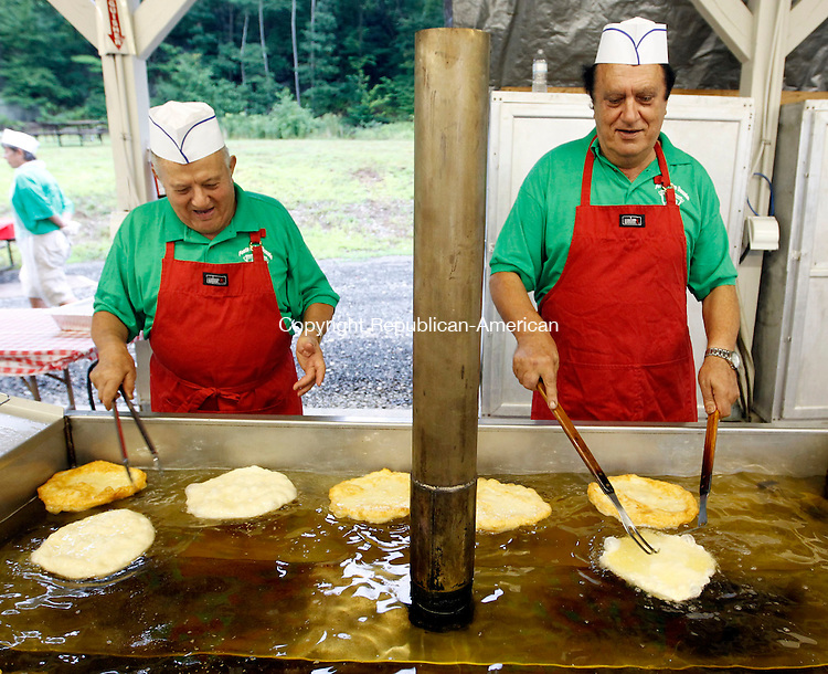 Waterbury, CT- 10 August 2013-080113CM04- Antonio Orsini, left, and Joseph Rinaldi of Waterbury  fry up Pizzelles, (fried dough with sauce) during the opening night of the 27th annual Festa di San Donato at the Pontelandolfo Community Club in Waterbury Thursday night.  The festivities continue Friday at 6 p.m and will run through 11 p.m.  Saturday the festival will open at 1 p.m. and close at 11 p.m. then Sunday will be begin at noon and conclude at 10 p.m.    The festival features music, soccer games, a cheese roll, authentic italian cuisine and Mass on Sunday at 10:30 a.m. at St. Lucy's Catholic Church on Branch Street.  The Mass will be followed by a processional.      Christopher Massa Republican-American
