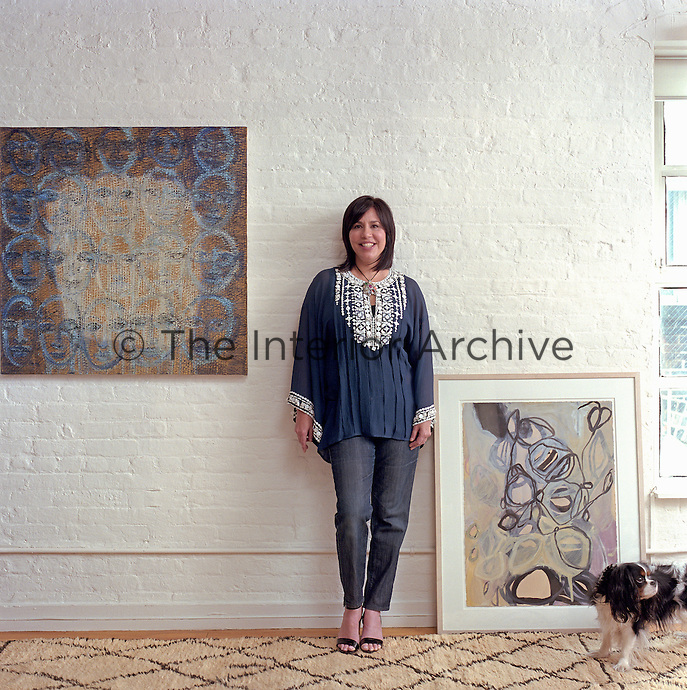 Designer Madeline Weinrib in her New York loft conversion with examples of her painting
