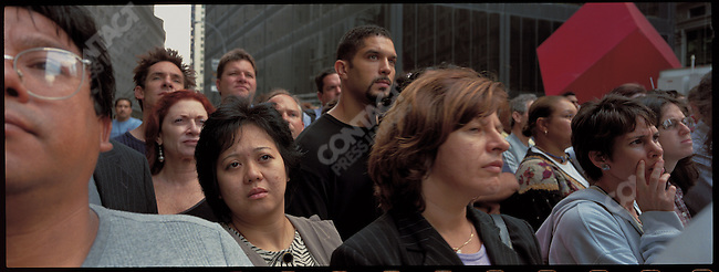 People stare at the World Trade Center disaster site near ground zero, New York City, New York, USA, September 29, 2001