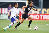 14 MAY 2011: Japan National team Yuki Nagasato chases USA Women's National Team midfielder Carli Lloyd (10) during the International Friendly soccer match between Japan WNT vs USA WNT at Crew Stadium in Columbus, Ohio.
