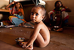 One year old Akash sits on the floor of a UNICEF feeding centre at  Shivpuri in Madhya Pradesh state in India.  Despite 15 yeas of economic growth the incidence of child malnutrition has barely changed -- 46 percent of children under 5 in India are malnourished: twice the rate of sub Saharan Africa.. A report released last week said a mixture of poor governance , the caste system dis-empowerment of women and superstition are preventing children from getting the nutrition they need, condemning another generation to brain damage, low earning potential and early death. At the moment 3000 children a day die in India as a result of malnutrition.