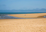 One person sunbathing alone on wide sandy beach at Hunstanton, north Norfolk coast, England