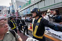 Riot police guard Left-wingers and activists against the Emperor system in Japan as they demonstrate against the visit of US President, Donald Trump to Japan and the Emperor system. Shinjuku, Tokyo, Japan. Sunday May 26th 2019. A small group of about 50 activists who object to the Japanese Imperial family system was met by a counter-protest of right-wingers and nationalists.