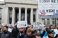 People gather outside MIT's student center in Cambridge, Massachusetts, during the March for Science demonstration on Sat., April 22, 2017. <br /> <br /> MIT's Building 7, the traditional entrance to the institution, is visible in the background.