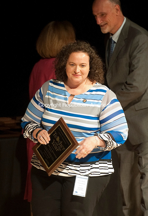 HARTFORD, CT--- -111015JS15--District Teacher of the Year for Cheshire schools, Anne Marie B. Wintenburg, receives her award during the annual Connecticut Teacher of the Year ceremony Tuesday at the Bushnell Theater in Hartford. <br /> Jim Shannon Republican-American