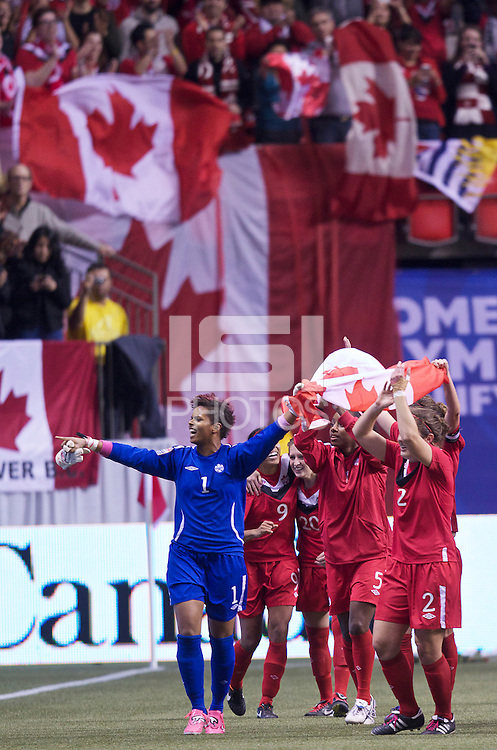 Members of the Canadian Women's National Team lead by Karina LeBlanc celebrating defeating Mexicoin the CONCACAF Olympic Qualifying semifinal match at BC Place in Vancouver, B.C., Canada Friday Jan. 27, 2012. Canada won the match 3-1 to earn a berth in 2012 London Olympics.