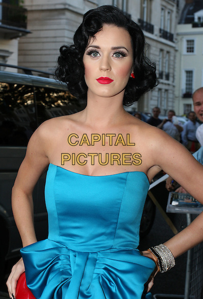 KATY PERRY.Glamour Women of the Year Awards 2009 at Berkeley Square Gardens, London, England..June 2nd, 2009.half length blue strapless bow dress hand turquoise cleavage hand on hip bracelets bow.CAP/ROS.©Steve Ross/Capital Pictures.