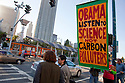 "Large ""Obama - Listen to Science Not Carbon Polluters"" banner. Hundreds of people gathered in downtown San Francisco for 350.org's International Day of Climate Action, October 24, 2009. Greenpeace, Mobilization for Climate Justice, and many others helped put on the local event. California, USA"