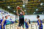 'Star' Kieran Donaghy, Garvey's Tralee Warriors, gets in to score under the basket when they met UCC Demons, Cork, last Saturday night at Tralee Complex.