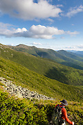 A hiker descends the Jewell Trail in the Presidential Range of the New Hampshire White Mountains during the summer months.