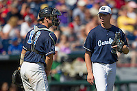 North Carolina pitcher Trent Thornton (31)talks with catcher Brian Holberton (10) during Game 7 of the 2013 Men's College World Series  against the Louisiana State Tigers on June 18, 2013 at TD Ameritrade Park in Omaha, Nebraska. The Tar Heels defeated the Tigers 4-2, eliminating LSU from the tournament. (Andrew Woolley/Four Seam Images)
