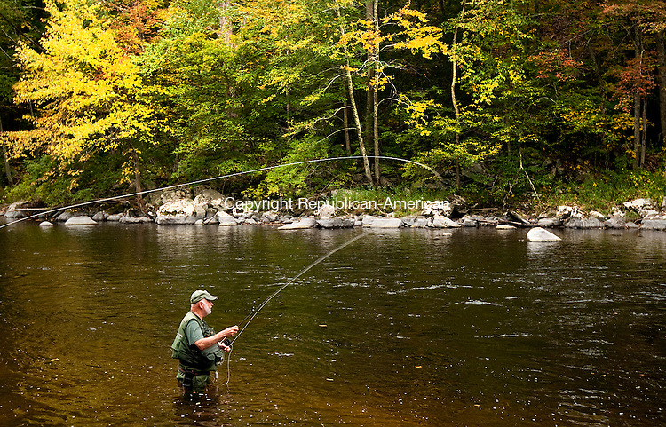 BARKHAMSTED, CT-092914JS01-  Among the early fall colors, David Charamut of Newington enjoys an afternoon fishing the Farmington River inside the Peoples State Forest in Barkhamsted on Monday. Charamut, who won a Hitchcock chair during the Riverton fishing derby in 1979, said he fishes the Farmington River a few times a week. <br /> Jim Shannon Republican-American