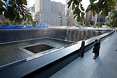 "Sept. 11, 2011.""Chuck Kennedy captured this scene with a remote camera as the President and First Lady, along with former President George W. Bush and former First Lady Laura Bush, paused at the North Memorial Pool of the National September 11 Memorial in New York City. The North Memorial pool sits in the footprint of the north tower, formerly 1 World Trade Center."" .Mandatory Credit: Chuck Kennedy - White House via CNP"