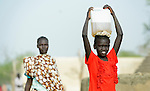 A displaced girl carries water on her head in Agok, a town in the contested Abyei region where tens of thousands of people fled in 2011 after an attack by soldiers and militias from the northern Republic of Sudan on most parts of Abyei. Although the 2005 Comprehensive Peace Agreement called for residents of Abyei--which sits on the border between Sudan and South Sudan--to hold a referendum on whether they wanted to align with the north or the newly independent South Sudan, the government in Khartoum and northern-backed Misseriya nomads, excluded from voting as they only live part of the year in Abyei, blocked the vote and attacked the majority Dinka Ngok population. The African Union has proposed a new peace plan, including a referendum to be held in October 2013, but it has been rejected by the Misseriya and Khartoum.