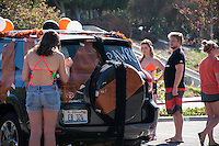 Occidental College athletic teams decorate their cars in Oxy spirit to participate in the annual Homecoming Parade. Judges rate the cars as they pass by, and students cheer on from the sides as they enjoy performances from Drumline and Dance Team. Oct. 23, 2014 (Photo by Nick Harrington, Occidental College Class of 2017)