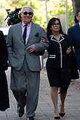 Roger Stone, former campaign adviser to United States President Donald J. Trump, left, and his wife Nydia Stone, right, arrive to federal court in Washington D.C., U.S., on Tuesday, November 5, 2019.  Credit: Stefani Reynolds / CNP