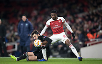 Ainsley Maitland-Niles of Arsenal & Michel of Qarabag during the UEFA Europa League match between Arsenal and Qarabag FK at the Emirates Stadium, London, England on 13 December 2018. Photo by Andy Rowland.