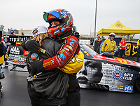 Nov 12, 2017; Pomona, CA, USA; NHRA top fuel driver Brittany Force (left) celebrates with sister Courtney Force after clinching the 2017 NHRA top fuel dragster world championship during the Auto Club Finals at Auto Club Raceway at Pomona. Mandatory Credit: Mark J. Rebilas-USA TODAY Sports