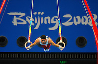 Aug. 9, 2008; Beijing, CHINA; Kai Wen Tan (USA) performs on the rings during mens gymnastics qualification during the Olympics at the National Indoor Stadium. Mandatory Credit: Mark J. Rebilas-