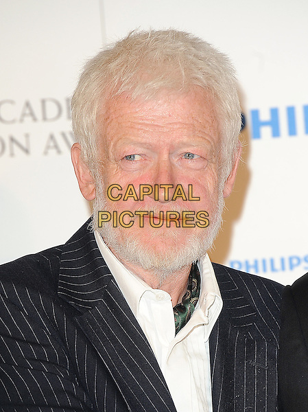 GUEST .in the press room at the Philips British Academy Television Awards (BAFTA) at the London Palladium in London, England, June 6th, 2010..BAFTAs TV portrait headshot beard facial hair  white shirt .CAP/BEL.©Tom Belcher/Capital Pictures.