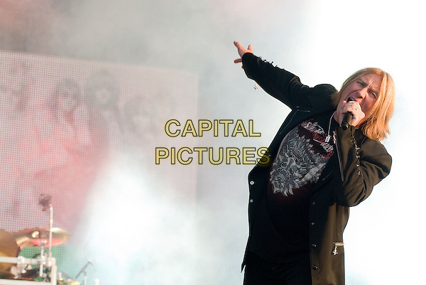 DEF LEPPARD - Joe Elliott.Download Festival 2009 - Day Three.Donington Park, Derbyshire, England..June 14th, 2009.stage concert live gig performing performance music half length black top jacket coat singing arm pointing .CAP/BRC.©Ben Rector/Capital Pictures.