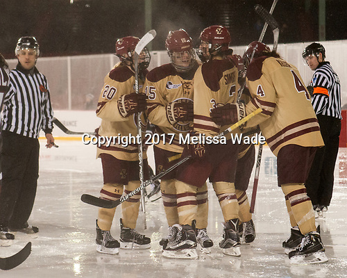 Ryan Little (BC - 20), Erin Connolly (BC - 15), Serena Sommerfield (BC - 3), Megan Keller (BC - 4) - The Boston College Eagles defeated the Harvard University Crimson 3-1 on Tuesday, January 10, 2017, at Fenway Park in Boston, Massachusetts.The Boston College Eagles defeated the Harvard University Crimson 3-1 on Tuesday, January 10, 2017, at Fenway Park.