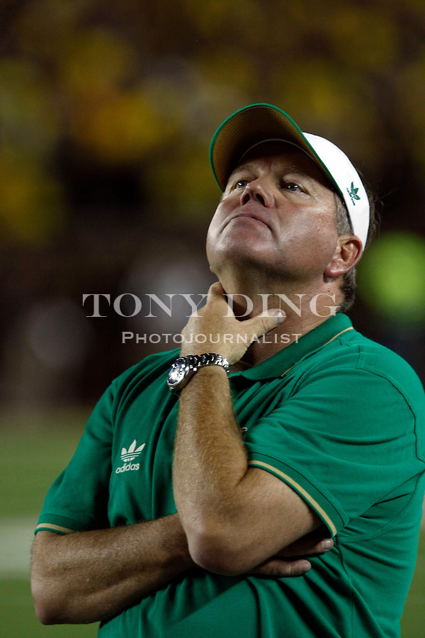 Notre Dame head coach Brian Kelly reacts in the final seconds of the fourth quarter of an NCAA college football game, Saturday, Sept. 10, 2011, in Ann Arbor. Michigan won 35-31. (AP Photo/Tony Ding)