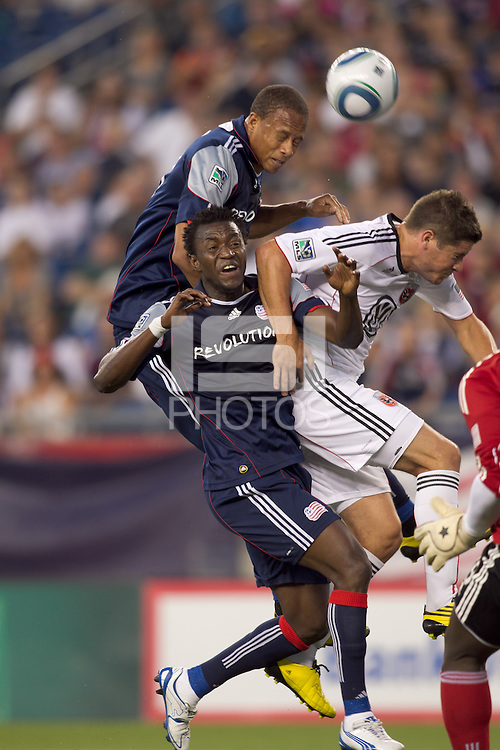 Corner kick action. New England Revolution forward Kenny Mansally (7), New England Revolution forward Khano Smith (18) and DC United midfielder Devon McTavish (18) battle. The New England Revolution defeated DC United, 1-0, at Gillette Stadium on August 7, 2010.