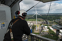 GERMANY Hamburg, wind turbine Siemens SWT-3.0-113 of Municipal energy supplier Hamburg Energie at Trimet aluminium company area / DEUTSCHLAND, Hamburg, Trimet Aluminium Werk Gelaende, Siemens Windkraftanlage SWT-3.0-113 des kommunalen Stromerzeuger Hamburg Energie, Siemens Service Techniker